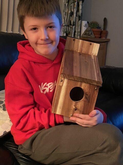 Cub holding home-made Bird Box